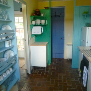 8) Kitchen. View towards shower room and laundry (washing machine/dryer)