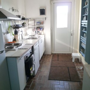 8) Kitchen. View towards the front door. Fridge/freezer, Dishwasher
